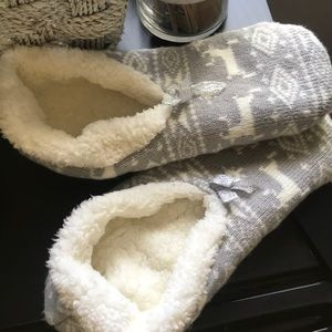 Shoes - Gray and white fluffy slipper socks.